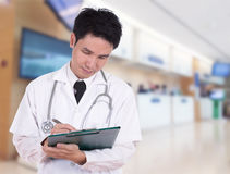 Doctor writting medical report Royalty Free Stock Image