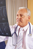 Doctor with x-ray image of human spine Stock Photo