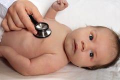 Doctor y bebé Foto de archivo