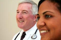 Doctor y enfermera Imágenes de archivo libres de regalías