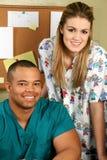 Doctor y enfermera que sonríen Fotografía de archivo libre de regalías
