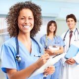Doctor y enfermeras Fotos de archivo