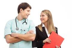 Doctor y especialista de las finanzas en hospital imagen de archivo libre de regalías