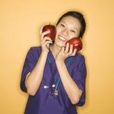 Doctor y manzanas. imagen de archivo libre de regalías