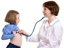 Doctor y niño Imagen de archivo