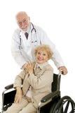 Doctor y paciente cómodos Imágenes de archivo libres de regalías