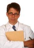 Doctor y sujetapapeles Imagen de archivo