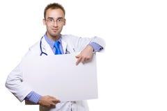 Doctor y tarjeta en blanco Foto de archivo