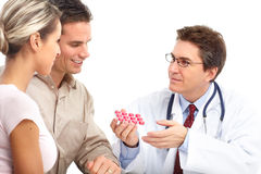 Doctor and young couple Stock Images