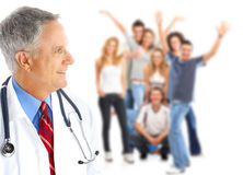 Doctor and young people Stock Image