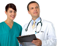 Doctor with young practitioner Stock Photos