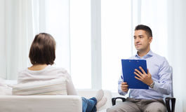 Doctor and young woman meeting at home visit Royalty Free Stock Photography
