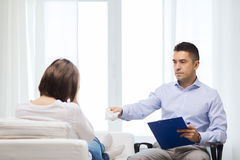 Doctor and young woman meeting at home visit Royalty Free Stock Images