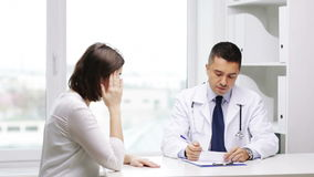 Doctor and young woman meeting at hospital stock video footage