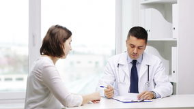 Doctor and young woman meeting at hospital stock footage