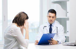 Doctor and young woman meeting at hospital Stock Images