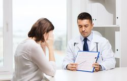 Doctor and young woman meeting at hospital Royalty Free Stock Images