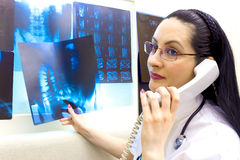 Doctoral consultation. A young doctor consults with his colleague over the phone, photography Stock Images