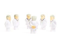 Doctores en el fondo blanco fotografía de archivo