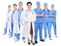 Doctores y cirujanos sonrientes felices Imagen de archivo libre de regalías