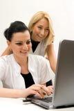 Doctores y computadora portátil Imagen de archivo libre de regalías