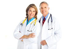 Doctors. Smiling medical doctors with stethoscope. Isolated over white background Stock Image