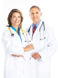 Doctors. Smiling medical doctors with stethoscope. Isolated over white background stock photography