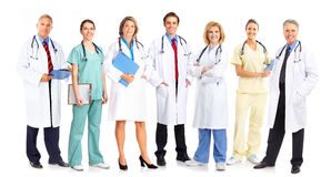 Doctors. Smiling medical people with stethoscopes. Doctors and nurses over white background royalty free stock images
