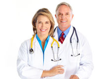 Doctors. Smiling medical doctors with stethoscope. Isolated over white background Royalty Free Stock Images