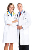 Doctors. Smiling medical doctors with stethoscope. Isolated over white background Royalty Free Stock Photography