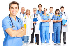 Doctors. Smiling medical doctors with stethoscopes. Isolated over white background royalty free stock photos