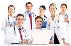 Doctors. Smiling medical doctors with stethoscopes. Isolated over white background stock images