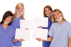 Doctors. Some lucky woman with cards Royalty Free Stock Images