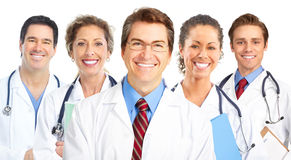 Doctors. Smiling doctors with stethoscopes. Isolated over white background stock images