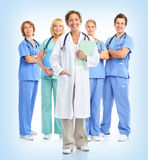 Doctors. Smiling doctors with stethoscopes. Over blue background stock photo