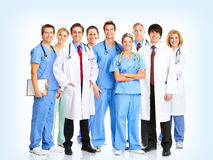 Doctors. Smiling doctors with stethoscopes. Over blue background stock image