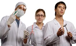 Doctors. Image about three colleagues - doctors in hospital on a symposium Royalty Free Stock Images