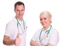 Doctors. A male and a female doctor on white background Stock Photography