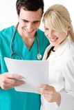 Doctors. Two young doctors reading results stock photography