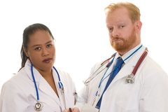 Doctors. Two doctors - man and woman - diverse. Focus on man