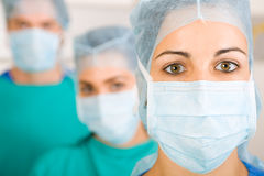 Doctors. Group of medical doctors in surgical gown and mask royalty free stock image