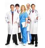 Doctors. Smiling medical people with stethoscopes. Doctors and nurses over white background Royalty Free Stock Photography