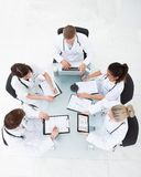 Doctors analyzing medical records Stock Image