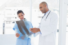 Doctors analyzing together xray Stock Photos