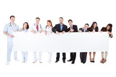 Doctors And Managers Showing Empty Banner Royalty Free Stock Photos
