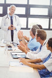 Doctors applauding a fellow doctor Stock Images