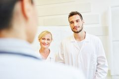 Doctors as colleagues. In hospital during meeting stock photography
