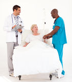 Doctors attending to a patient Royalty Free Stock Photos