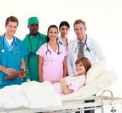Doctors attending to a patient Royalty Free Stock Images