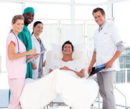 Doctors attending to a patient smiling at the came Royalty Free Stock Photos